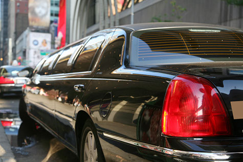 Columbia SC Lincoln Town Car Stretch Limousine drives through the streets with clients for their special occasion.